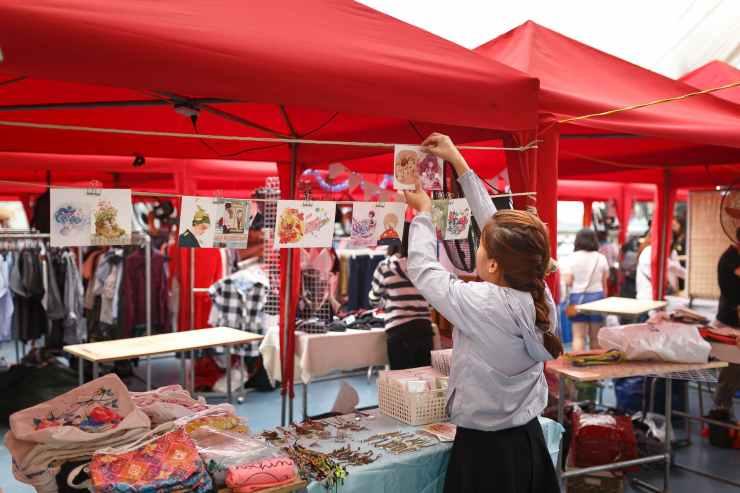 girl arranging displays for sale